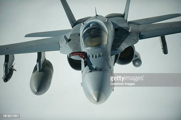 february 26, 2012 - a u.s. navy f/a-18c hornet receives fuel over afghanistan from a kc-10 extender.   - asian hornet stock pictures, royalty-free photos & images
