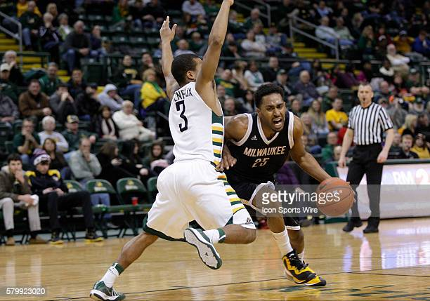 Milwaukee Panthers guard Steve McWhorter drives past Wright State Raiders guard Reggie Arceneaux during the NCAA Basketball game between the Wright...