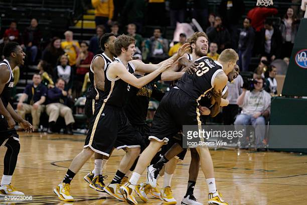 The Milwaukee Panthers celebrate a victory after a last second shot by Milwaukee Panthers forward JJ Panoske during the NCAA Basketball game between...