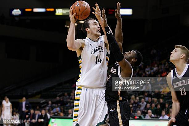 Wright State Raiders center Michael Karena shoots over Milwaukee Panthers guard Akeem Springs during the NCAA Basketball game between the Wright...