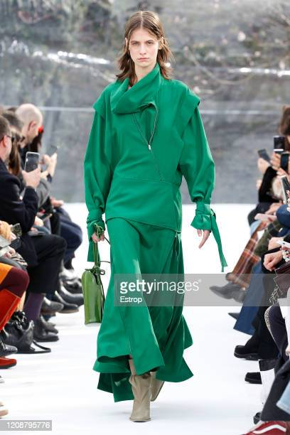 A model walks the runway during the Kenzo show as part of the Paris Fashion Week Womenswear Fall/Winter 2020/2021 on February 26 2020 in Paris France