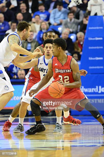 Duquesne guard Desmond Ridenour guarded by Saint Louis University guard Austin McBroom during an Atlantic 10 Conference game between the Duquesne...