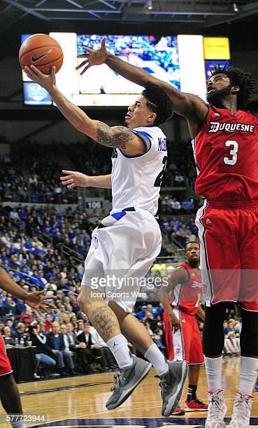 Saint Louis University guard Austin McBroom socres over Duquesne forward Dominique McKoy during an Atlantic 10 Conference game between the Duquesne...
