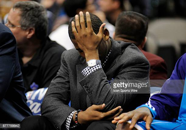 New Orleans Hornets guard Chris Paul who did not play due to injury reacts after Dallas takes a large lead in the 2nd quarter in an NBA game between...