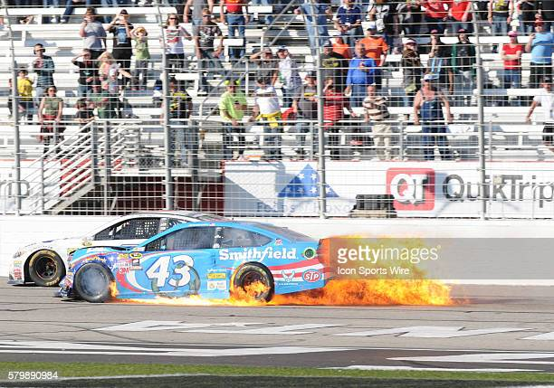 Aric Almirola Richard Petty Motorsports Smithfield Foods Ford Fusion brings out the caution to end the race after crashing during the Sprint Cup...