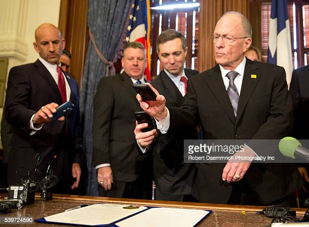 Several Texas State Senatos and Representatives take photos with their cell phones of the proclamation declaring February 2nd 2015 is to be Chris...