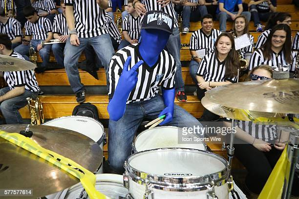 Villanova drummer wears a blue spandex suit while giving the
