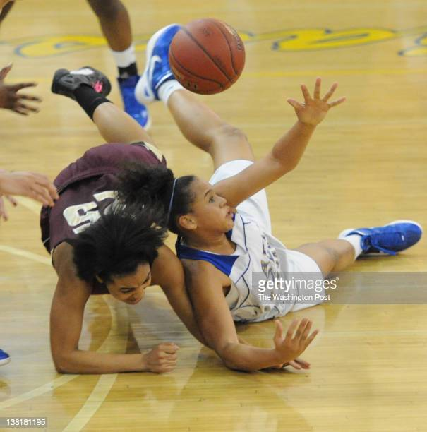 Gaintersburg G Janeesa Fauntroy battles Paint Branch G Erin French for a loose ball during 2nd half action on February 3 2012 in Gaithersburg MD