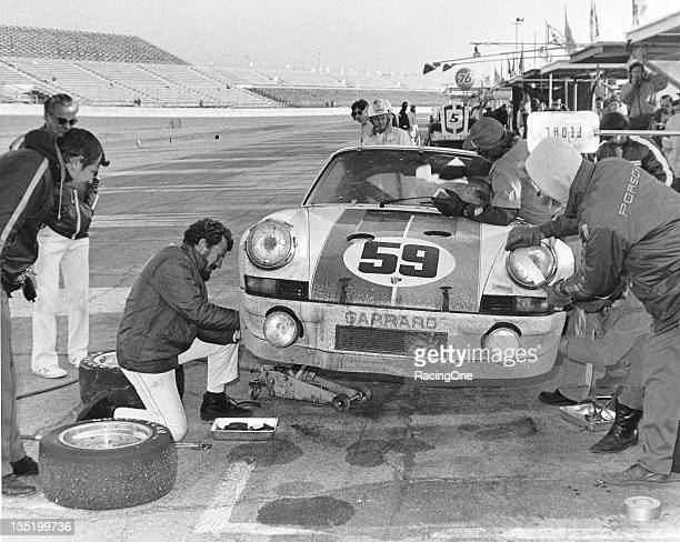 The winning Porsche 911 Carrera RSR gets pit road attention late in the running of the 24 Hours of Daytona at Daytona International Speedway Owned by...