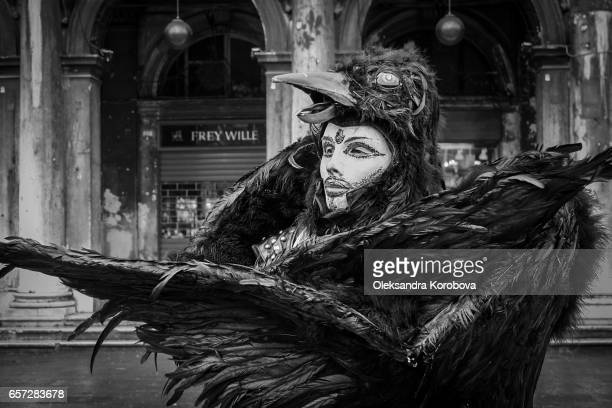 February 4, 2008. Venice, Italy. Black and white image of a street performer dressed as a bird for the annual Carnival.