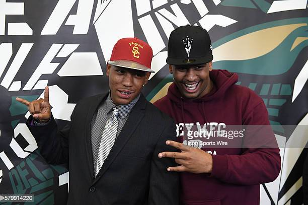 Iman Marshall of the Long Beach Poly High School Jackrabbits with Poly teammate Joseph Wicker as Marshall announces his choice to sign with the USC...
