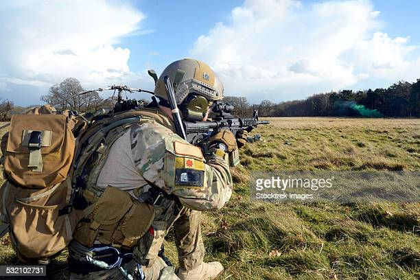 February 6, 2014 - Airman sets up a perimeter defense at the Stanford Training Area, England.