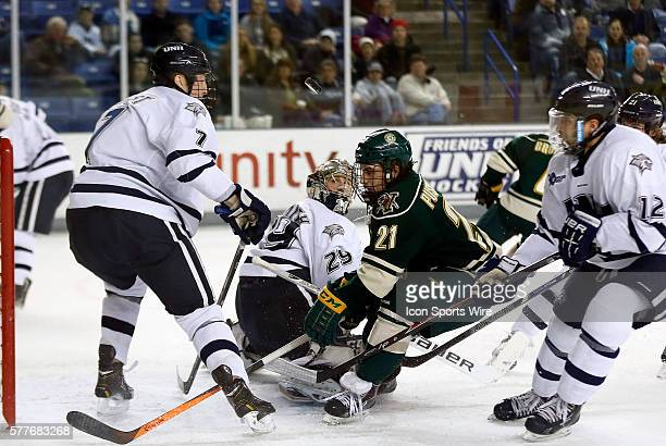 University of New Hampshire's Casey DeSmith follows his tip to the netting with Vermont's Mario Puskarich crashing the net The University of Vermont...