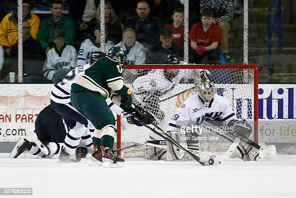 University of New Hampshire's Casey DeSmith waits for the shot from Vermont's Jake Fallon The University of Vermont defeated the University of New...