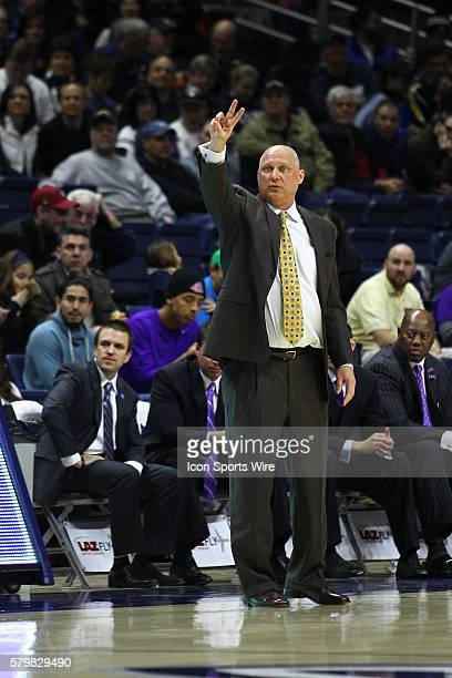 ECU's Head Coach Jeff Lebo on the sidelines during a Men's American Athletic Conference D1 basketball matchup between the ECU Pirates and the UConn...