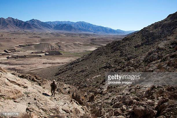 February 8, 2013 - U.S. Marine climbs a hill to conduct a site survey in the Kajaki district, Helmand Province, Afghanistan.