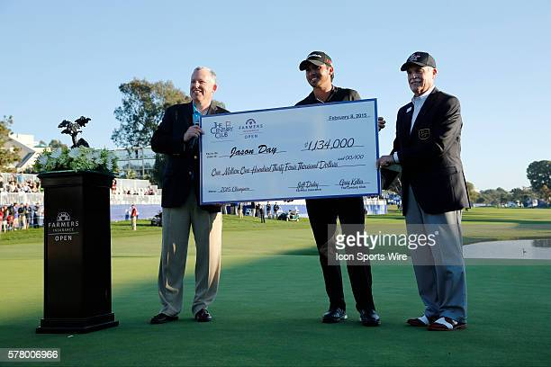 Jason Day poses with a giant check after his victory during the final round of the Farmers Insurance Open at Torrey Pines in La Jolla, CA.