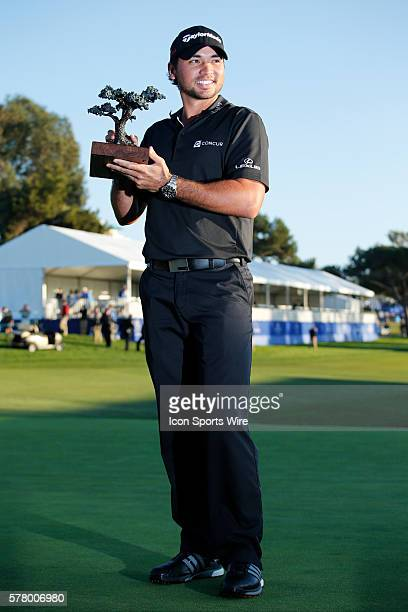 Jason Day poses with the championship trophy after his victory during the final round of the Farmers Insurance Open at Torrey Pines in La Jolla CA