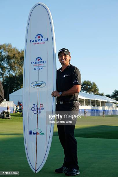 Jason Day with a surfboard after the final round of the Farmers Insurance Open at Torrey Pines in La Jolla, CA.