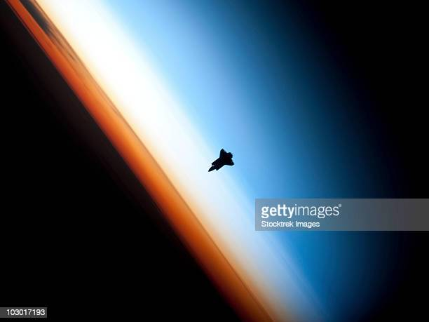 February 9, 2010 - Silhouette of space shuttle Endeavour over Earth's colorful horizon.