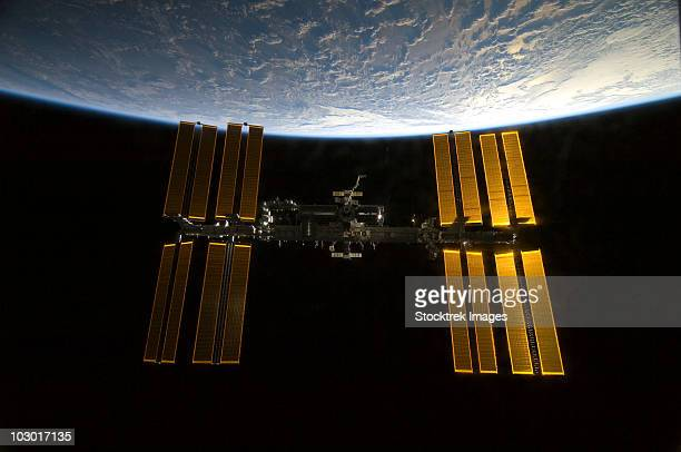 February 9, 2010 - The International Space Station backdropped by Earth's horizon and the blackness of space.