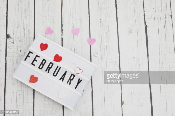 february written in a lightbox
