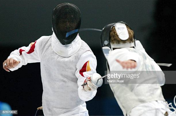 Fechten Olympische Spiele Athen 2004 Athen Florett / Mannschaft / Maenner Finale ITA / CHN Ye CHONg / CHN Salvatore SANZO / ITA 210804