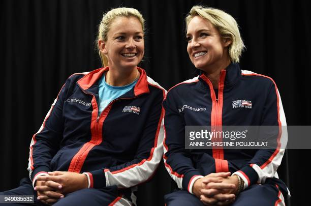 US Fed Cup players Coco Vandeweghe and Bethanie MattekSands share a light moment during the draw ahead of the Fed Cup semifinal tennis tie between...