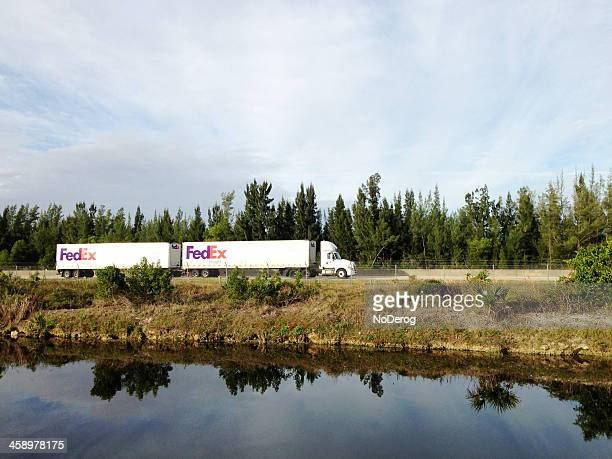 fed ex freight truck on highway - federal express stock pictures, royalty-free photos & images