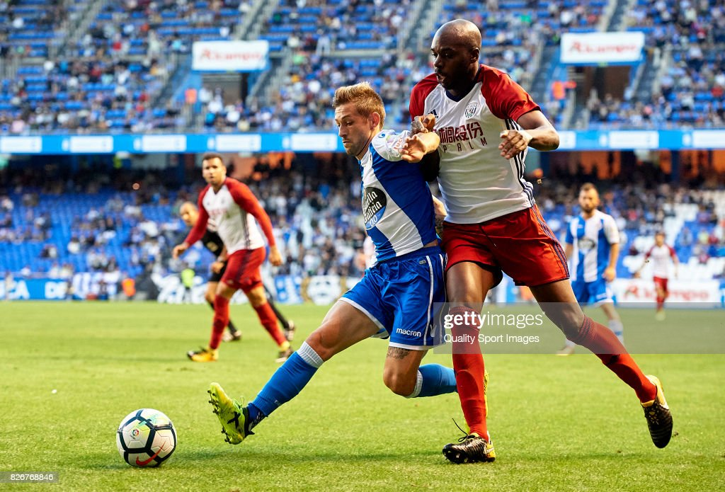 Fede Cartabria of Deportivo de La Coruna is challenged by Allan-Romeo Nyom (R) of West Bromwich Albion during the Pre Season Friendly match between Deportivo de La Coru?a and West Bromwich Albion at Riazor Stadium on August 5, 2017 in La Coruna, Spain.
