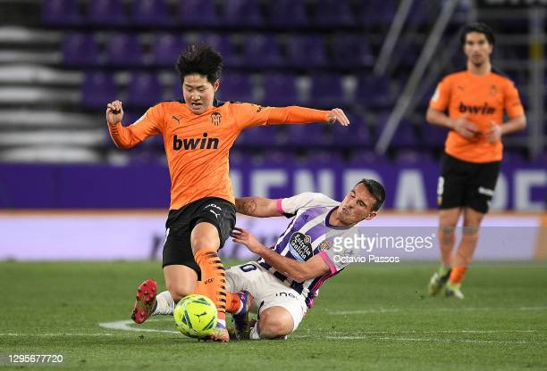 Fede of Real Valladolid tackles Lee Kang-In of Valencia during the La Liga Santander match between Real Valladolid CF and Valencia CF at Estadio...