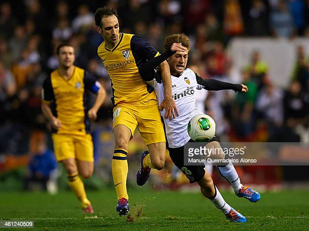 Fede of Valencia competes for the ball with Juanfran of Atletico de Madrid during the Copa del Rey round of 16 first leg match between Valencia CF...