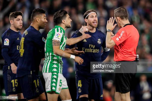 Fede Valverde of Real Madrid Casemiro of Real Madrid Marc Bartra of Real Betis Sergio Ramos of Real Madrid referee Gonzalez Gonzalez during the La...