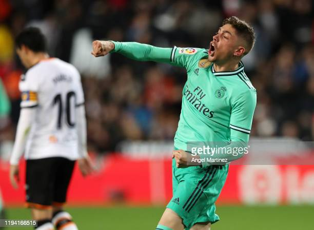 Fede Valverde of Real Madrid celebrates his team's equaliser goal scored by teammate Karim Benzema during the Liga match between Valencia CF and Real...