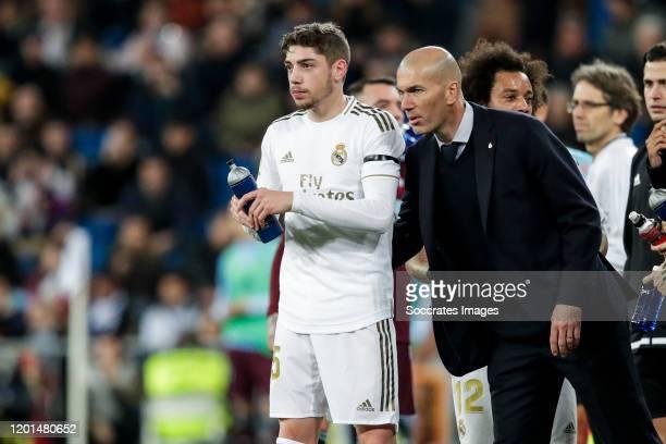 Fede Valverde of Real Madrid coach Zinedine Zidane of Real Madrid during the La Liga Santander match between Real Madrid v Celta de Vigo at the...