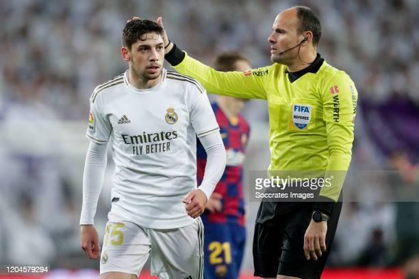 Fede Valverde of Real Madrid referee Mateu Lahoz during the La Liga Santander match between Real Madrid v FC Barcelona at the Santiago Bernabeu on...