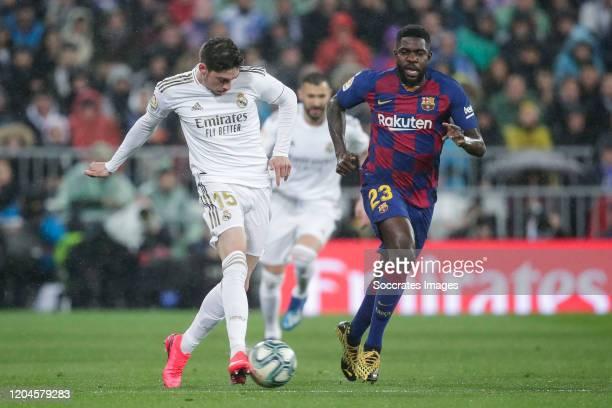 Fede Valverde of Real Madrid Samuel Umtiti of FC Barcelona during the La Liga Santander match between Real Madrid v FC Barcelona at the Santiago...