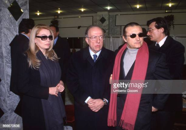Fedele Confalonieri the Italian singer Tony Renis and Silvio Berlusconi's wife Veronica Lario at the funeral chamber of the military hospital in...