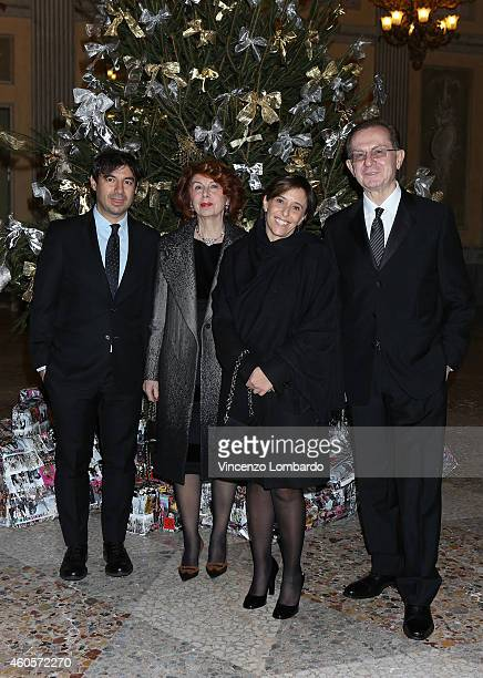 Fedele Usai and wife Gianpaolo Grandi and wife attend the Fondazione IEO CCM Christmas Dinner For on December 16 2014 in Monza Italy