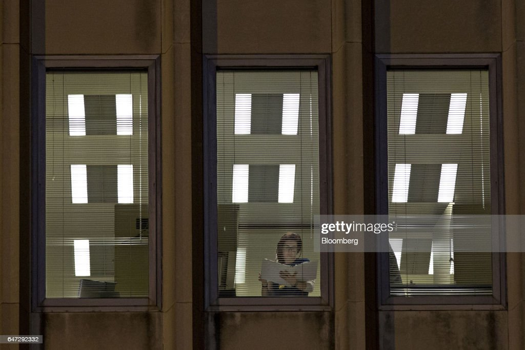 a u s federal agent police officer looks through a binder as a
