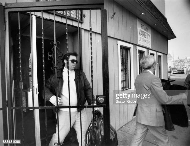 Federal agents carry evidence seized from Rotary Variety a convenience store on Old Colony Avenue in South Boston on Jan 17 1990 Federal state and...