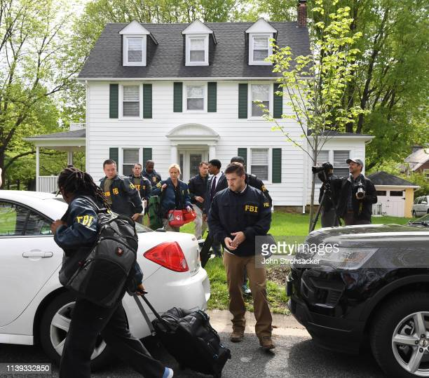 Federal agents remove items from the home of Baltimore Mayor Catherine Pugh in the 3400 block of Ellamont Rd as they execute a search warrant on...