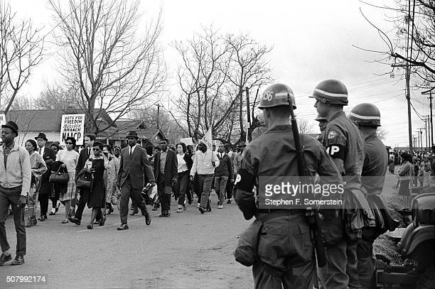 Federal Army troops guard civil rights marchers striding along route 80 the Jefferson Davis Highway during the Selma to Montgomery Civil Rights March...