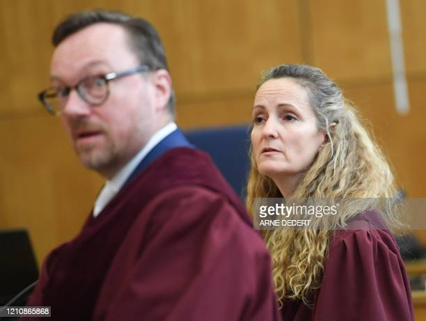 Federal attorneys Anna Zabeck and Christian Rietscher arrive for the start of the trial of an Iraqi man identified only as Taha alJ believed to have...