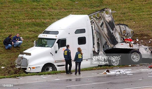 Federal Bureau of Alcohol Tobacco and Firearms agents inspect the tractor of a FedEx 18wheeler truck on Interstate 270 after apparently hitting an...