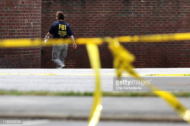 Federal Bureau of Investigation agents continue to process the crime scene following a mass shooting at the City of Virginia Beach Operations...