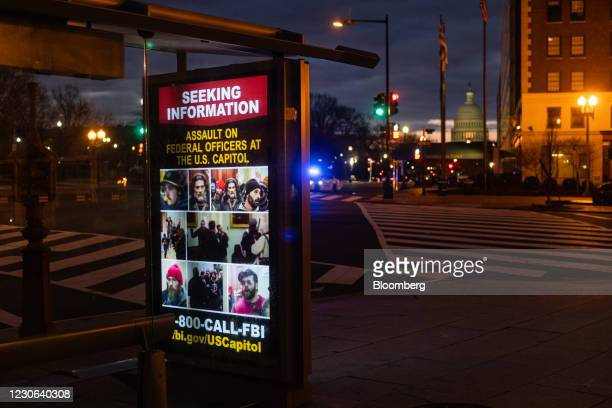 Federal Bureau of Investigation bulletin seeking to identify Capitol rioters displayed at a bus stop near the U.S. Capitol in Washington, D.C., U.S.,...