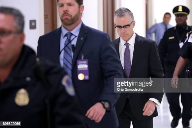 Federal Bureau of Investigation Deputy Director Andrew McCabe is escorted by US Capitol Police before a meeting with members of the Oversight and...