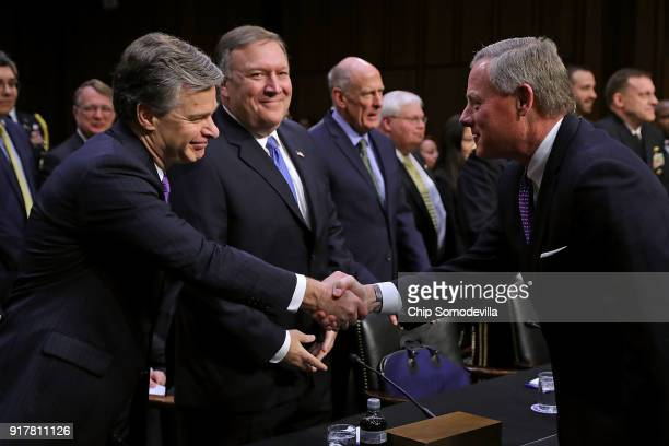 Federal Bureau of Investigation Director Christopher Wray and Central Intelligence Agency Director Mike Pompeo greet Senate Intelligence Committee...