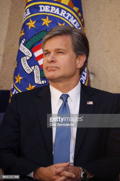 Federal Bureau of Investigation Director Christopher Wray attends his installation ceremony at FBI headquaters September 28 2017 in Washington DC...